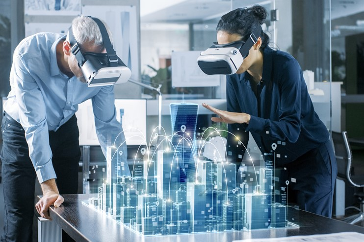 Two engineers using VR headsets looking at a virtual city